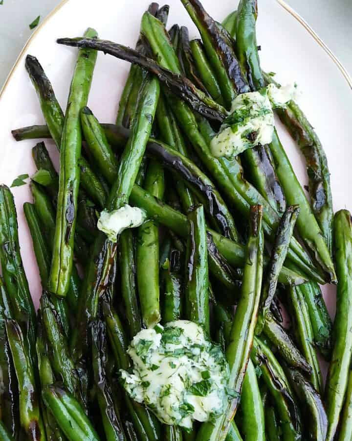 square image of of garlic butter green beans on a serving platter