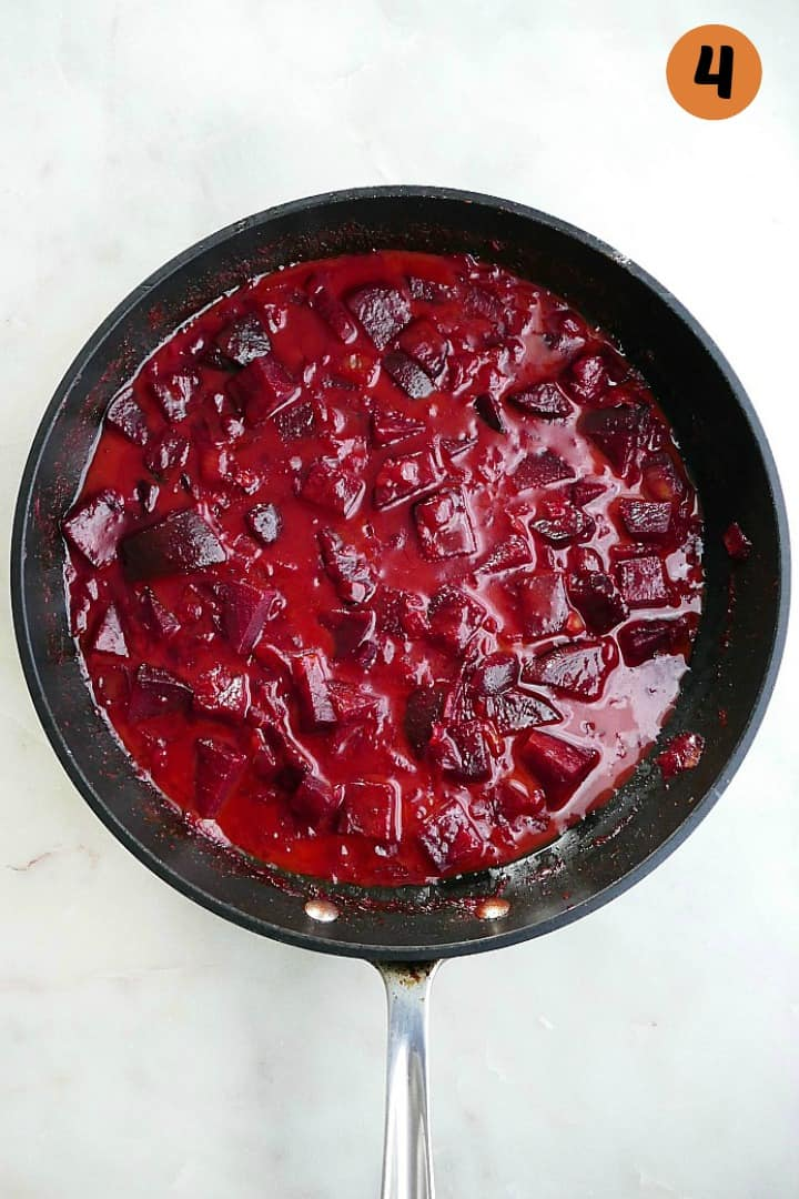 curry with coconut milk and beets in a skillet with the number four in the corner