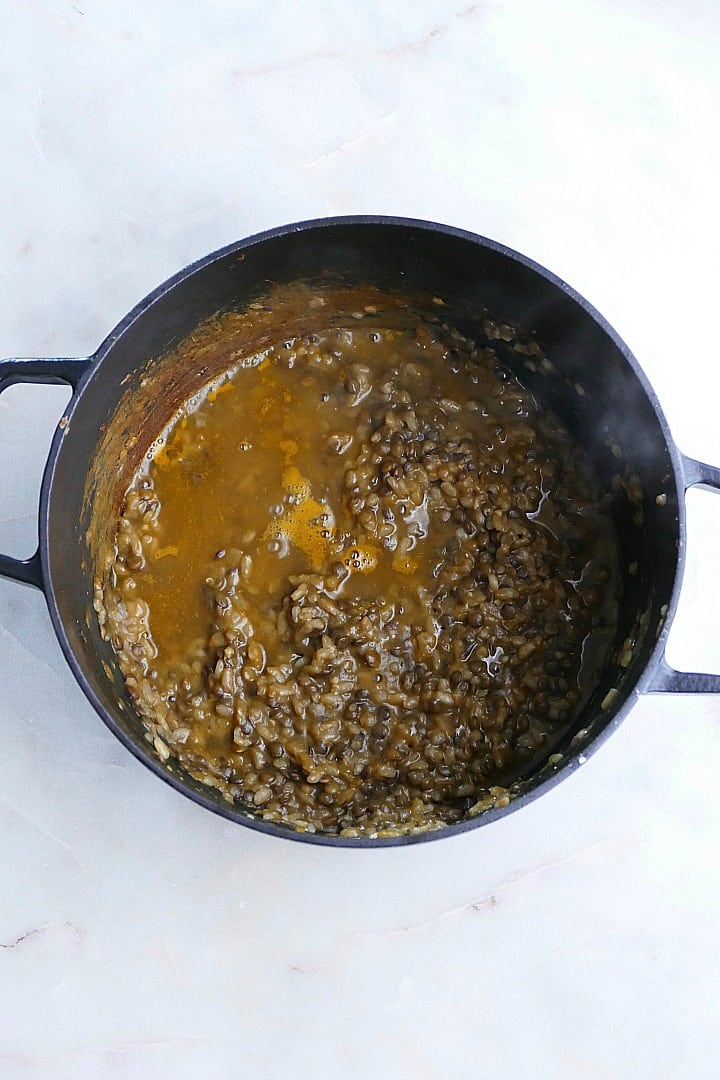 lentil risotto in a large Dutch oven on a counter