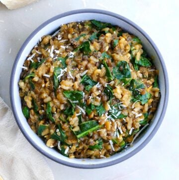 square image of lentil risotto with collard greens on a counter