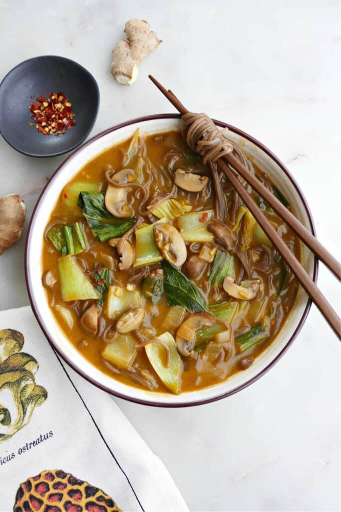 bok choy miso soup in a soup bowl with chopsticks on the edge on a counter