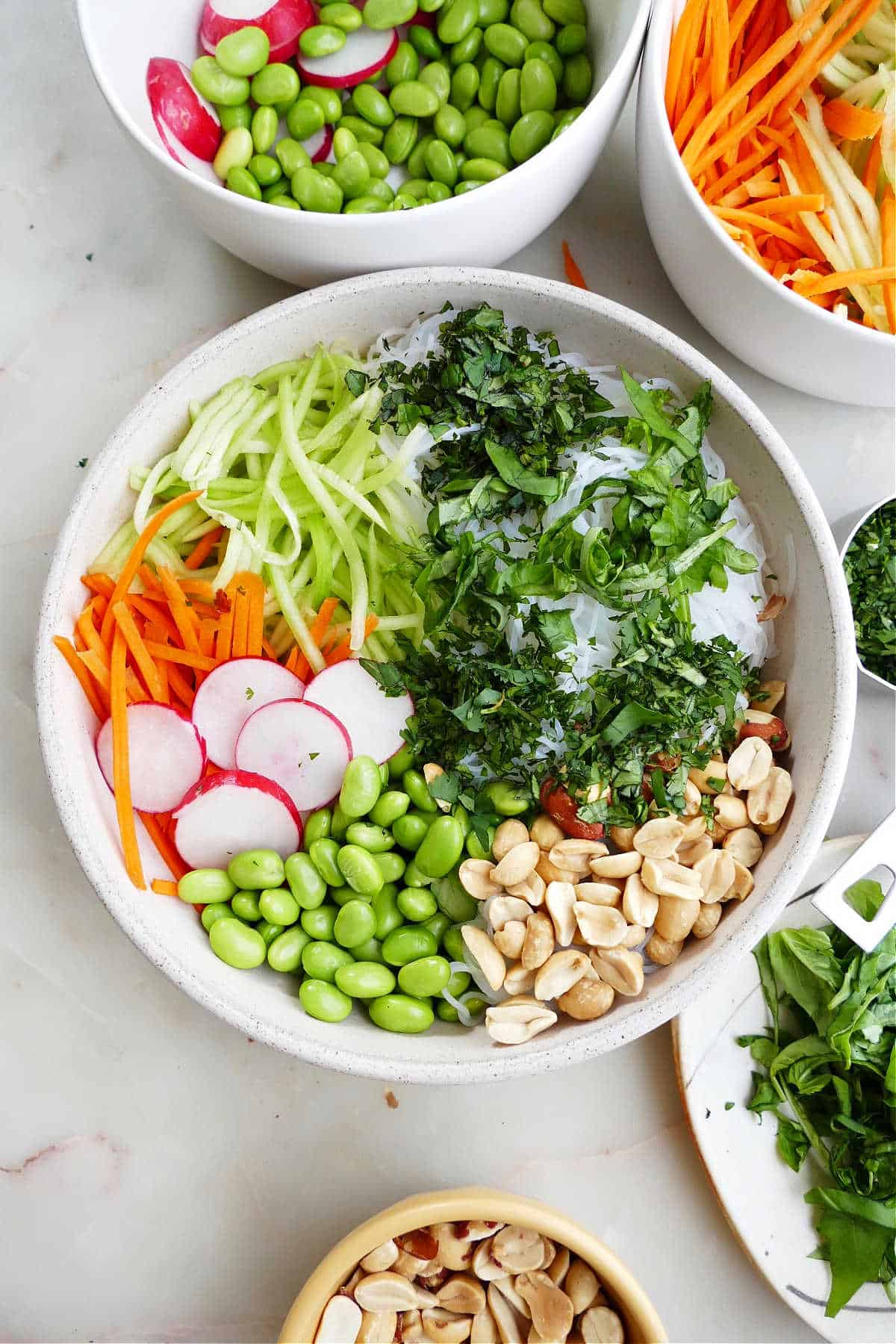 image of spring roll bowl with toppings before being mixed together