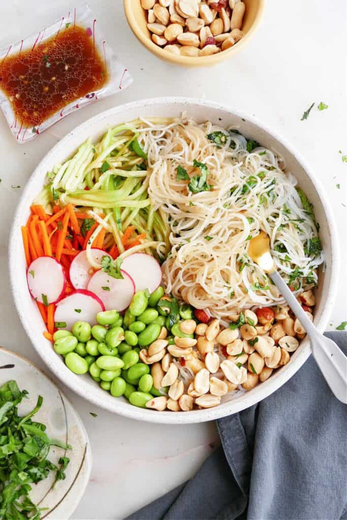 deconstructed spring roll in a bowl with toppings on a counter