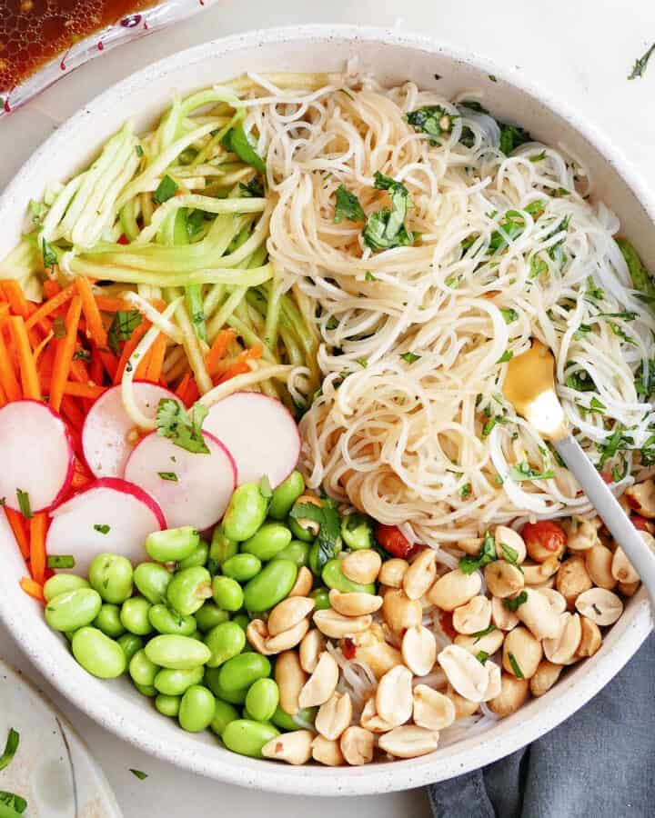 square image of a spring roll bowl with toppings on a counter