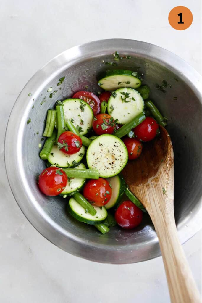 summer vegetables in a bowl with the number one in a circle in the top right