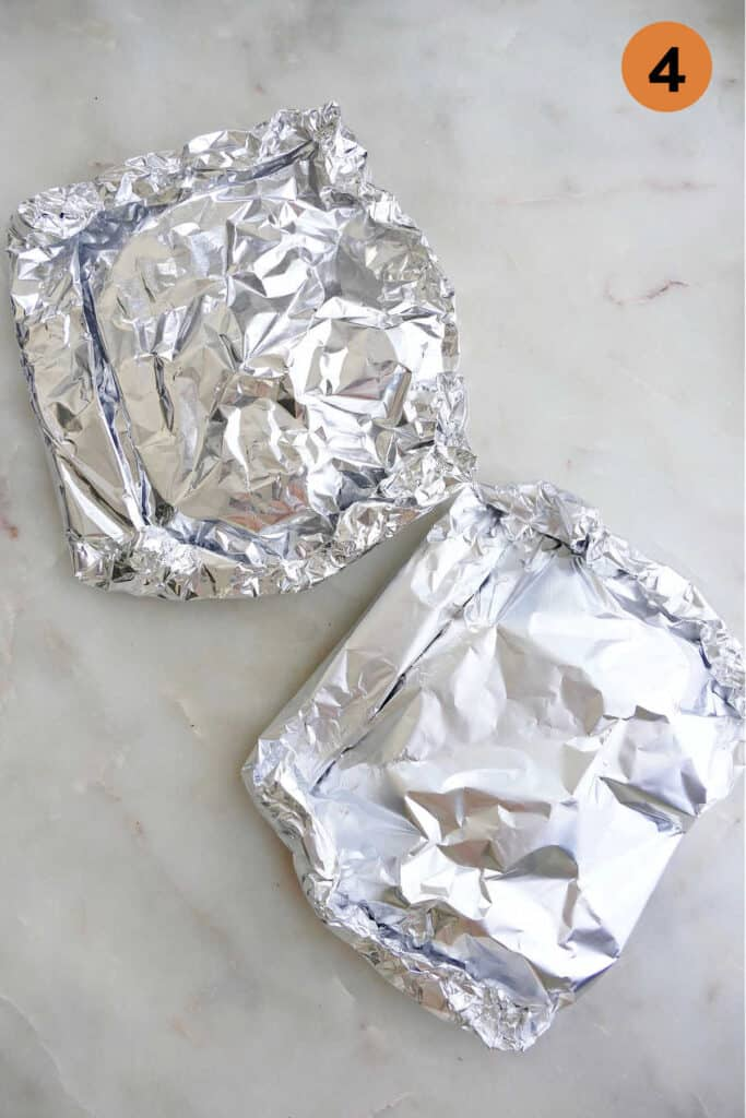 two cod foil packets on a counter with the number four in a circle in the top right