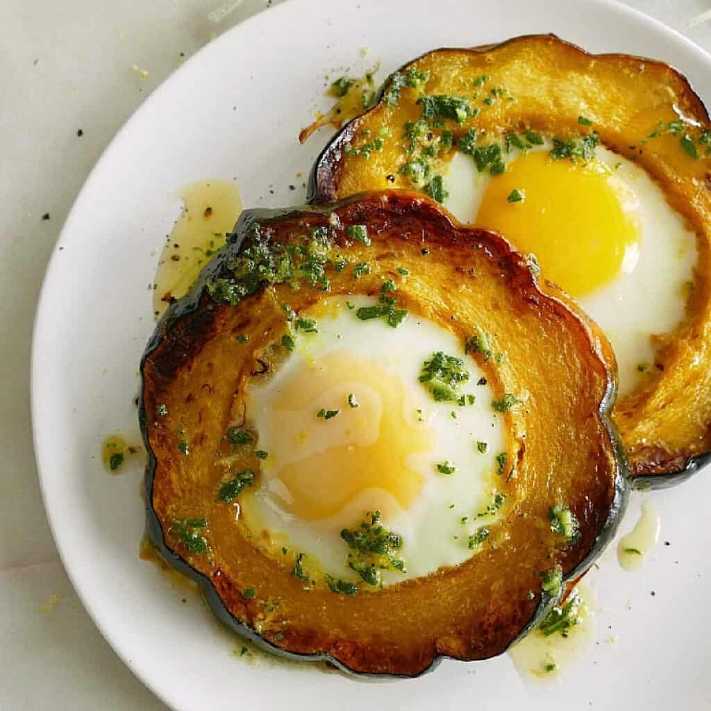 acorn squash eggs-in-a-hole with sage brown butter on a plate