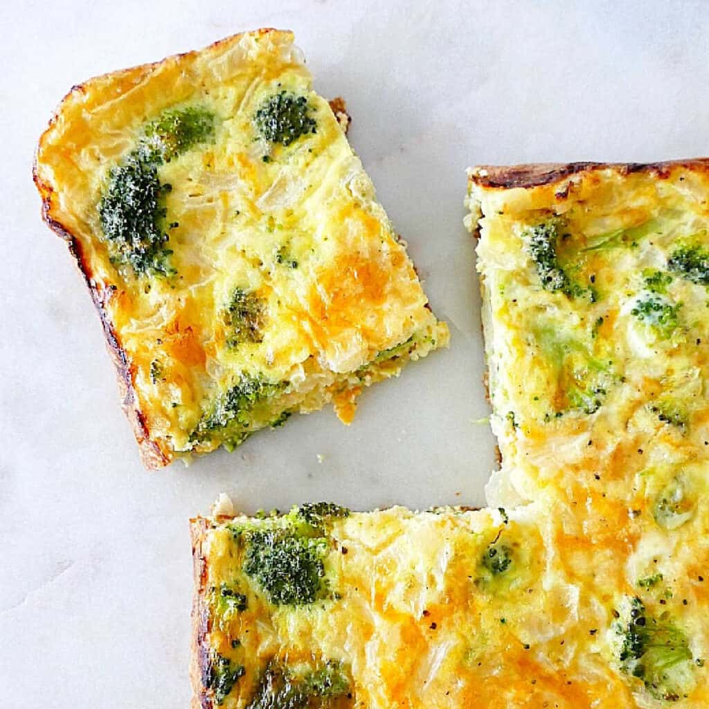 broccoli and cheese egg bake on a counter with one slice cut