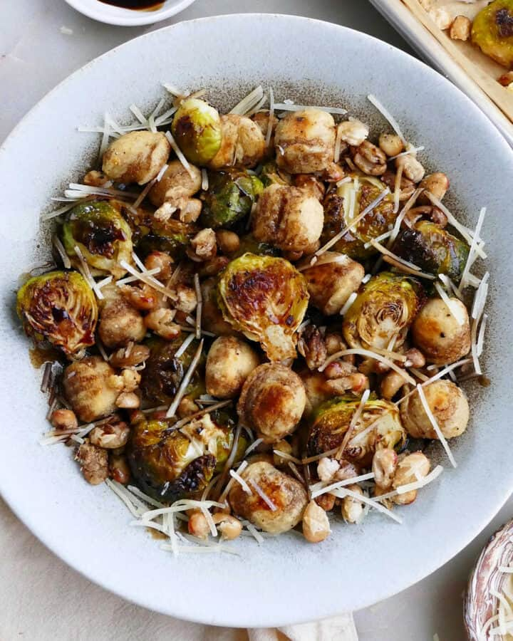gnocchi, Brussels sprouts, white beans, parmesan, and balsamic reduction in a serving bowl